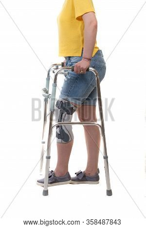 Woman With Walking Frame And Nee Orthosis