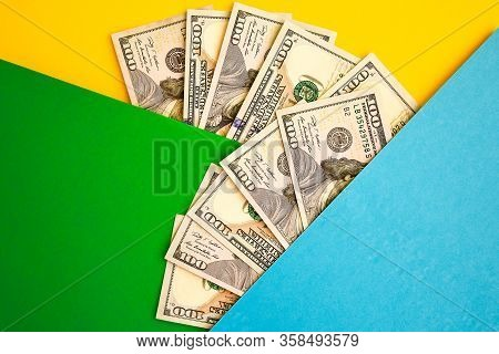 Cash Money On Colorful Background, Fan Of 100 Dollar Bills On Color Background, Copy Space For You T