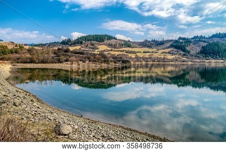 Water Reflection On Lake Liptovska Mara, Slovakia. Clouds On Sky And Beautiful Nature