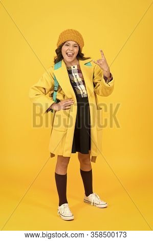 In Rock Style. Small Girl Gesture Horn Sign In Formal Style. Little Cute Child Wear Autumn Fashion S