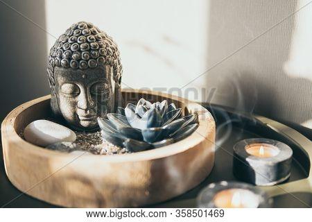 Meditation Decoration With Buddha Statue, Candle Lights Smoke And Lotus Flower.