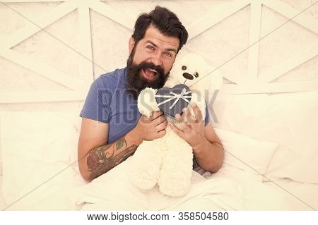 Spread Love. Present For Sweetheart. Man Hug Soft Toy Relaxing In Bed. Make Surprise Concept. Gift F