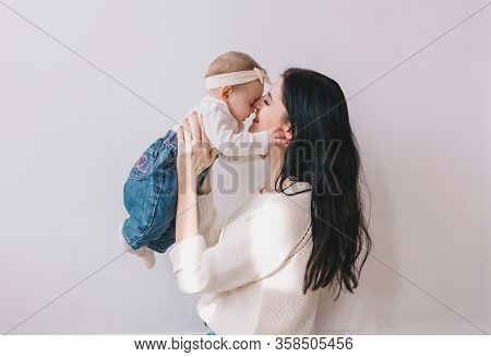 Mother And Child . Mom And Baby Girl Playing In Sunny Room. Mother And Child Girl Playing, Kissing A