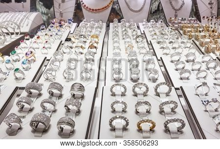 Dubai, UAE - January 31, 2020: Shop window of a jewelery store with rings of platinum with diamonds at the Golden Souk market in Deira district in Dubai