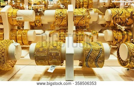 Dubai, UAE - January 31, 2020: Shop window of a jewelery store with bracelets of gold at the Golden Souk market in Dubai, United Arab Emirates