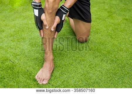 Close Up On Shin Injury. The Man Use Hands Hold On His Shin While Running
