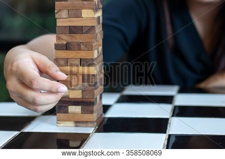 Growing Business Concept. Business Woman Picking Domino Blocks For Filling The Missing Dominus And P