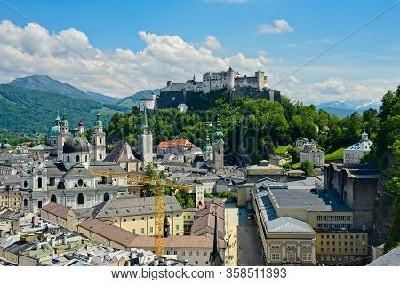 The Classic View Of Salzburg, Austria, With The Festung Hohensalzburg Looking Down On The Old Town F