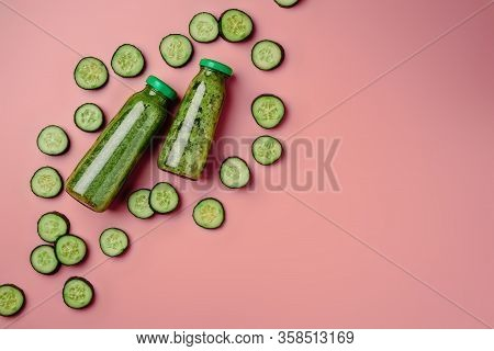 Cucumber Vegan Smoothie, Nutrient Hydrating Green Juice, Detox Food, Weight Loss Concept, Pink Backg