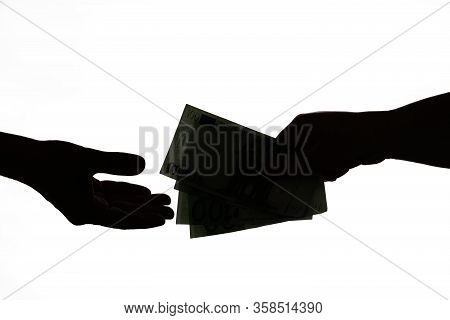 Silhouette Of Business Man Hands Giving Bribe Isolated On Gray Background. Dark Economy, Corruption