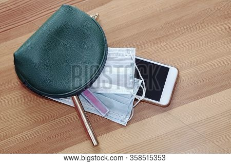 Green Woman Cosmetic Bag With Protruding Two Sanitary Masks, Mobile Phone, Lipstick And Make Up Penc