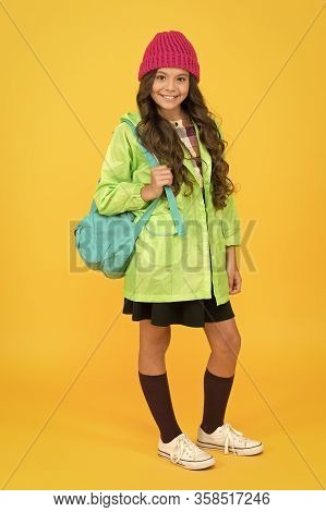 Autumn Brings School. Happy Schoolchild Yellow Background. Little Girl Smile With School Bag. Small