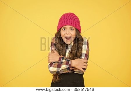 She Is Cold. Unhappy Little Child Feel Cold Yellow Background. Small Girl Shiver In Cold Weather Hea