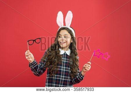 Eyewear Booth Props. Little Cute Bunny. Having Fun. Schoolgirl Bunny Ears. Girl In Easter Bunny At E