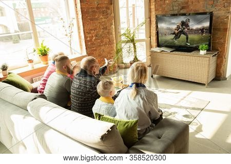 Excited Caucasian Family Watching American Football Championship, Sport Match At Home. Grandparents,