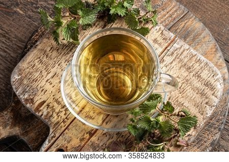 Herbal Tea Made From Stinging Nettles On A Table