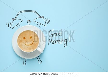 Composition With Good Morning Wish And Aromatic Coffee On Light Blue Background, Top View. Space For