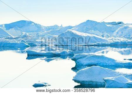 Big Iblue Cebergs In Ilulissat Icefjord At Sunset. Ilulissat Village, Western Greenland
