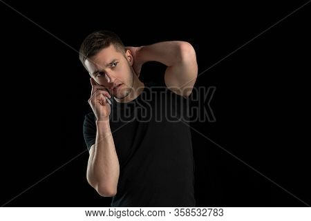 Talking On Phone. Monochrome Portrait Of Young Caucasian Man Isolated On Black Studio Background. Be