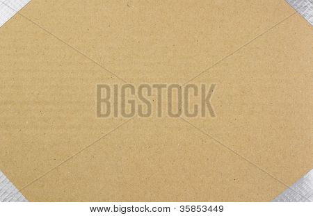 background of brown cardboard with duct taped edges with room for text or label (copy space)