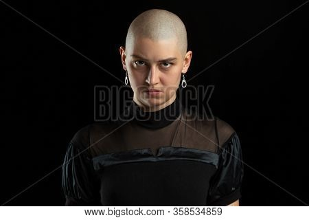 Serious, Mystic. Monochrome Portrait Of Young Caucasian Bald Woman Isolated On Black Studio Backgrou