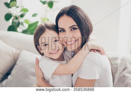 Closeup Photo Of Pretty Little Girl Leaning Cheek To Young Charming Attractive Mommy Hugging Holding