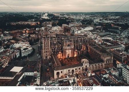 The Cathedral of Saint Mary of the See or Seville Cathedral aerial view as the famous landmark in Seville, Spain.
