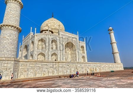 Agra, India - March 5 2018: Tourists Sighteseeing, Exploring And Admiring Famous The Taj Mahal While