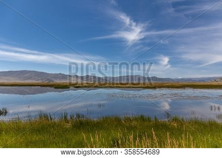 Wild Mountain Lake In The Altai Mountains, Summer Landscape, Mongolia Landscape. Altai Tavan Bogd Na