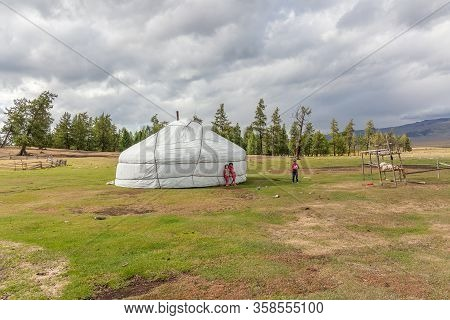Altai, Mongolia - June 14, 2017: Dry Mongolian Landscapes In The Altai Mountains, Wide Landscape. Ch