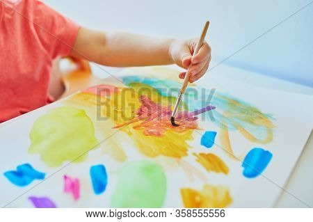 Girl Drawing With Colorful Aquarelle Paints At Home, In Kindergaten Or Preschool. Creative Games, Ed