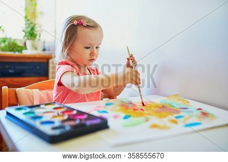 Adorable Little Girl Drawing With Colorful Aquarelle Paints At Home, In Kindergaten Or Preschool. Cr
