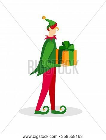 Christmas Elf Character Boy In Green Costume And Funny Hat Holding Gift In Hands Isolated On White B