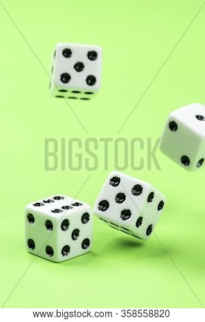 Concept Photo Of Rolling The Dice. A Conceptual Photo Of Dice Being Rolled On A Green Table.