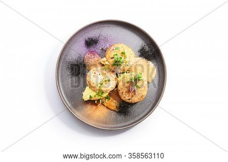 Fishcakes with garden cress top view. Delicious filleted fish with greenery on tray. Croquette seafood with aromatic sauce. Restaurant dish, culinary presentation. Food composition