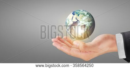 Globe ,earth in human hand, holding our planet glowing. Earth image Furnished by Nasa
