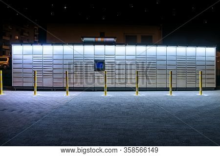 Electronic Locker,  Automated Parcel Terminal (parcel Locker, Post Terminal, ) On The Street With Em