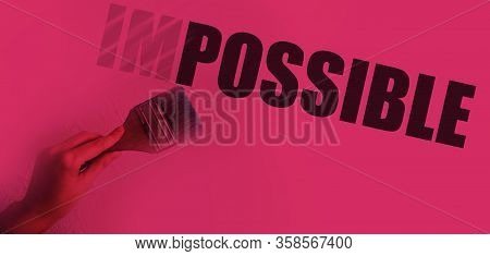Impossible Into Possible Word Transforming With Paintbrush In Hand In Magenta Duotone. Challenging B