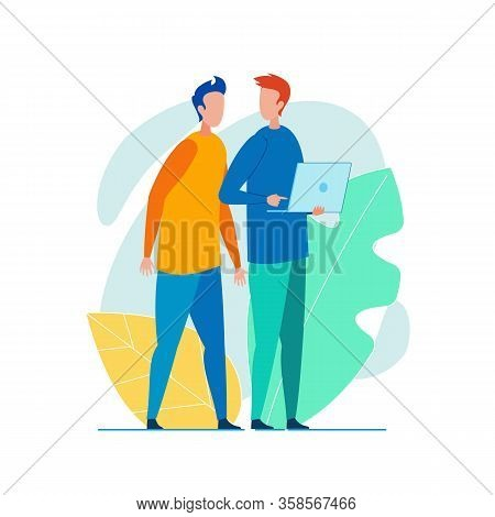 Office Worker, Dressed Casually, With Laptop In His Hands, Showing Something On Screen To Colleague,