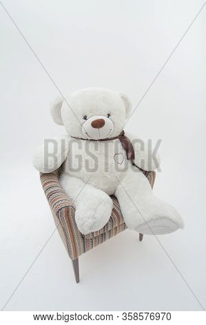 White Teddy Bear In Chair. Isolated On White Background