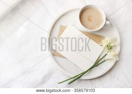 Breakfast In Bed Mockup Scene Near Window. Cup Of Coffe, Greeting Card, Narcissus, Daffodil Flowers