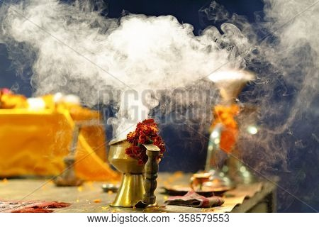 Incense burning and flowers of French Marigold for the Ganga Aarti ceremony in Varanasi, India