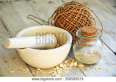 Oatmeal Powder For Washing Concept Natural Cosmetic. A White Mortar With A Pestle In Which Oatmeal I