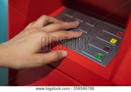 Woman Hands To Press The Atm Key In The Red Cabinet.  Finger   Pressing A Pin Code On A Number Pad.