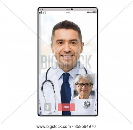 medicine, technology and online communication concept - video chat of happy smiling male doctor and senior woman patient on smartphone