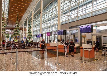 Calgary, Canada - Dec. 21, 2019: Passengers At The International Departure Gate Of Terminal Of Calga