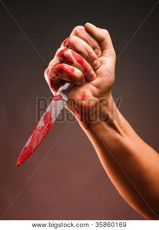 Bloody stabbing. Hand with knife