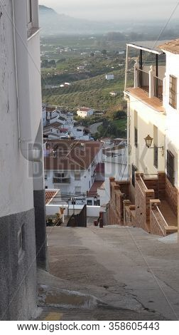 View Of Andalusian Valley From Top Of Steep Village Street