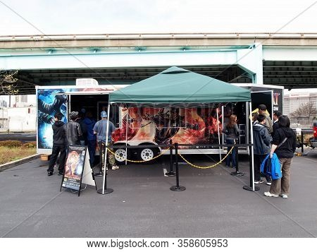 San Francisco - March 26, 2011:  People Checkout Mortal Kombat 9 Booth Outside Of Best Buy.  The Gam