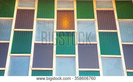Image Of A Multicolored Stained Glass Window. Uneven Glass Surface Background Image. Window Oak Bark
